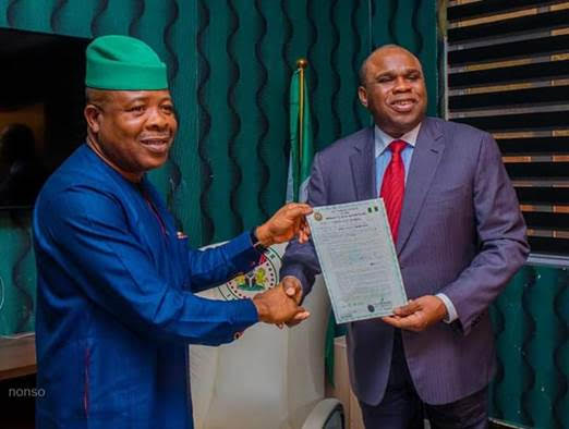 Afreximbank President Prof. Benedict Oramah (right) receiving certificate of occupancy for land for quality assurance centre from Imo State Governor Emeka Ihedioha in Owerri.