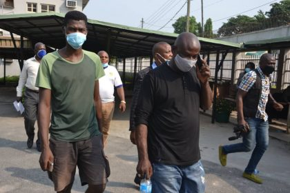 Vanger Luper (right) and Bright Ogbuagu during their arraignment for alleged adulteration of automobile engine lubricants by the Standards Organisation of Nigeria (SON) at the Federal High Court, Ikoyi Lagos, Wednesday