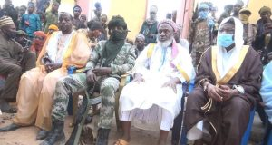 Kachalla Turji, in military camouflage, with Gumi on white, among other fighters