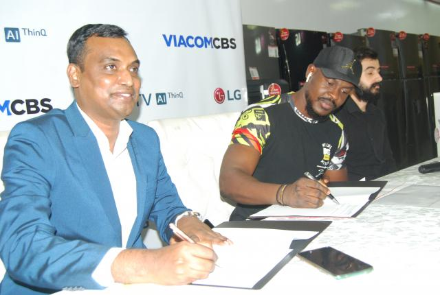 PIX L-R: Head, Corporate Marketing, LG Electronics West Africa Operations, Mr. Hari Elluru, Country Manager, ViacomCBS, Mr. Bada Johnson and Head, Showroom Operations, Fouani Nigeria Limited, Mr. Souhad Achour at the official announcement of LG/VaicomCBC Media Advertising and Sponsorship deal held at LG Showroom, Lekki Lagos Nigeria, today.