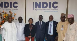 Managing Director/Chief Executive, Nigeria Deposit Insurance Corporation (NDIC) Bello Hassan (centre) poses for a group photograph with the President Nigerian Guild of Editors (NGE) Mustapha Isah (3rd right) during a courtesy call by the Guild to the Executive Management of the NDIC in Abuja. They are flanked by (L –R) NDIC Executive Director Operations, Mustapha M. Ibrahim, NGE General Secretary Iyobosa Uwugiaren, NDIC Executive Director Corporate Services Hon. Mrs. Omolola Abiola-Edewor, NGE Deputy President, Ali M. Ali and NGE Member Standing Committee, Gbenga Adeshina.