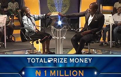 Frank Edoho, right, host of Who wants to be a millionaire